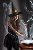 Beautiful long haired girl dressed like a halloween — Stock Photo