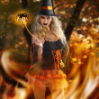Witch with magical spider wand - Stock Photo