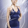 Royalty-Free Stock Photo: Elegant blonde model wearing a blue dress and make up