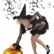 Stock Photo: Pretty girl dressed up as a halloween witch