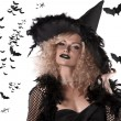 Royalty-Free Stock Photo: Portrait of a curly blonde wearing a huge witch hat