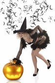 Pretty girl dressed up as a halloween witch — Stok fotoğraf