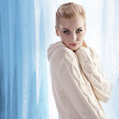 Beautiful blonde wearing a warm wool sweater — Stock Photo