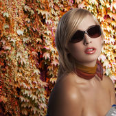 Blond girl portrait with dark sunglasses — Stock Photo