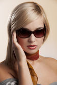 Blond lady portrait with sunglasses — Stock Photo