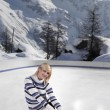 Young beautiful woman with ice skates — Stock fotografie