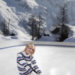 Young beautiful woman with ice skates — Stock Photo