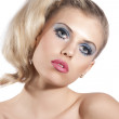 Blond girl with creative make up posing — Stock Photo