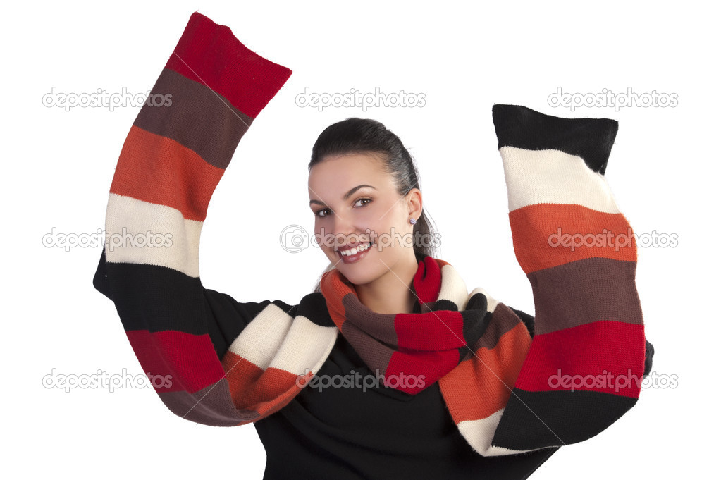 Autumn shot of a happy young pretty brunette wearing a dark sweater and a fall color long scarf  — Stock Photo #7267328