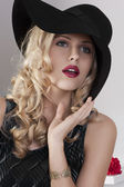 Portrait of a fashion girl with black hat — Stock Photo