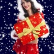Brunette as santa claus in sow - Stock Photo
