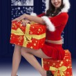 Santa claus brunette with presents — Stock Photo