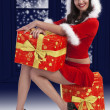 Santa claus brunette met presenteert — Stockfoto