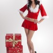 Santa claus brunette and christmas gifts — Stock Photo