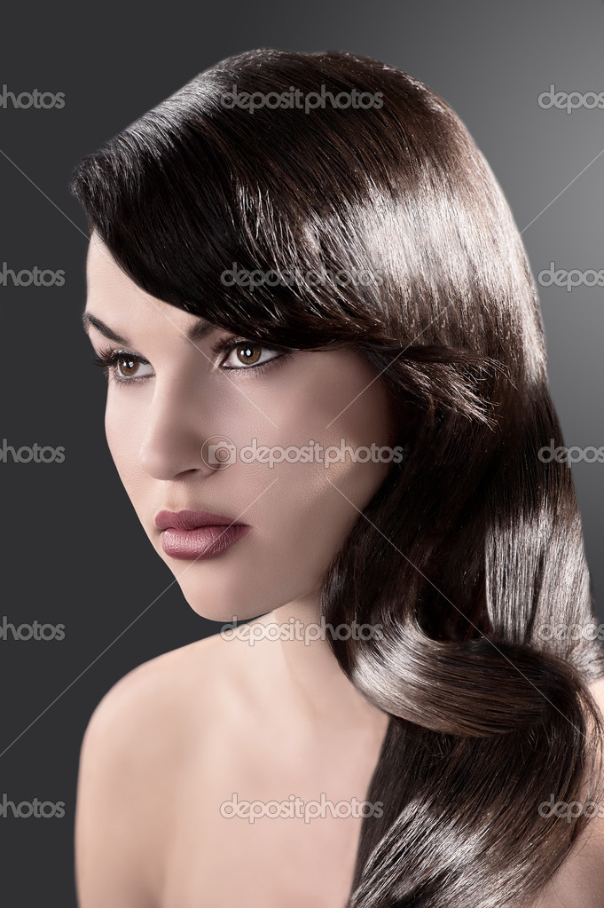 Beauty close up portrait of a long haired brunette with very shiny hair  Stock Photo #7358591