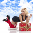 Sensul girl with sexy pose with gift box — Stock Photo #7388959