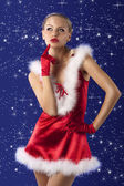 Red and sexy santa claus girl — Stock Photo
