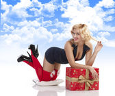 Sensul girl with sexy pose with gift box — Stock Photo