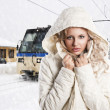 Girl with white hood, she's adjusting the neck of the jacket — Stock Photo