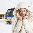 Girl with white hood, she's adjusting the neck of the jacket - Stock Photo
