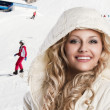 Girl with white hood, she's cold, foreground beautiful smile - Foto de Stock