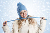 Blue hat on a blond girl, node with pitgals of the hat. — Stock Photo