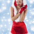 Sexy santa claus girl clapping hands — Stock Photo