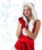 Christmas young girl dressed in red clapping hands — Stock Photo
