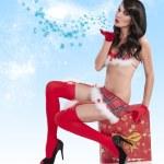 Christmas girl blowing a kiss — Stock Photo