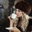 Elegant blond girl drinking a cup of tea — Stock fotografie
