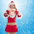 Royalty-Free Stock Photo: Santa claus girl showing gift box
