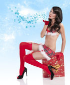 Christmas girl blowing a kiss — Stock Photo
