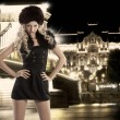 Stockfoto: Blond girl with hand on hips and fur hat