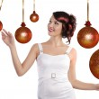 Preety girl playing between the christmas ball — Stock Photo