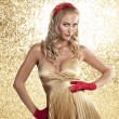 Elegant christmas girl in a champagne color dress — Stock Photo #7562162