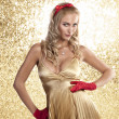 Elegant christmas girl in a champagne color dress — Stock Photo