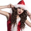 Curly brunette dressed as santa claus — Stockfoto