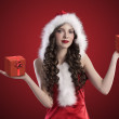 Sweet santa brunette spreading her arms — Stock Photo #7571875