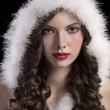 Gorgeous young girl with a santa hood — Stock Photo #7571884