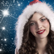 Curly brunette with santa hood — Stock Photo #7571897