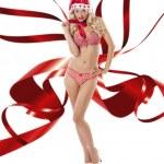 Sexy santa claus with ribbon wings — Stock Photo