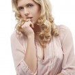 Blond young girl with curly hair with attractive pose — Stock Photo