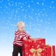 Christmas baby boy with gift box, he has his hands on the big gi — Stock Photo