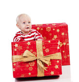 Christmas baby boy with gift box, baby is sitting — Stock Photo