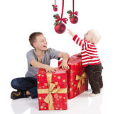 Christmas baby boy with gift box. He is with his brother — Stock Photo