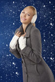 Cute girl ready for the winter cold day posing and smiling — Stock Photo