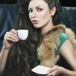 Young elegant girl in green with cup, she is bringigng the cup t — Stock Photo #7850888