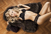 Sexy girl in lingerie with fur, her arms are open — Stock Photo