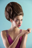 Pretty in pink with couture hair style — Stock Photo
