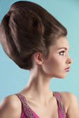 Brunette with elegant up-do and pink dress — Stock Photo
